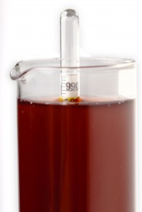The density of wine in a test tube is determined through the use of a hydromete, which floats at different heights according to the density of the liquid (in accordance with Archimedes' Principle