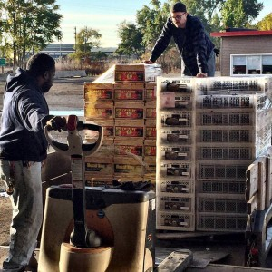 loading wine grapes into customer trucka